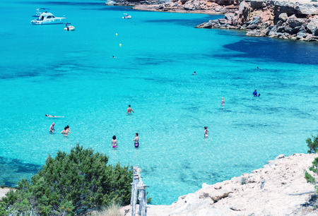 formentera: FORMENTERA, SPAIN - JUNE 4, 2015: Cala Saona Beach with tourists. Formentera is a very famous tourist attraction.