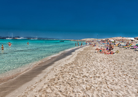 formentera: FORMENTERA, SPAIN - JUNE 5, 2015: Ses Illetes Beach with tourists. Formentera is a very famous tourist attraction.