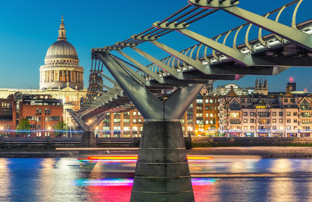Millennium Bridge and St Paul Cathedral at dusk. Wonderful London summer skyline.