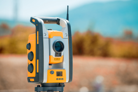 tacheometer: Surveyor equipment tacheometer or theodolite outdoors at construction site.