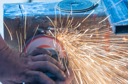 sharpening: Drill sharpening with grindstone abrasive disc cutter machine.