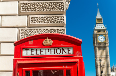 phonebox: Red Telephone Booth and Big Ben in London street.