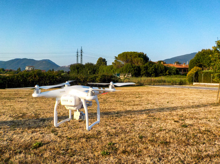 phantom: PISA, ITALY - JULY 19, 2015: Drone Phantom 3 hovers in the air. DJI Phantom 3 is the latest drone from market leader DJI.