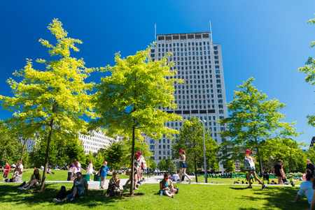 garden city: LONDON - JUNE 16, 2015: Tourists relax on Jubilee Gardens. The city attracts 50 million people annually.