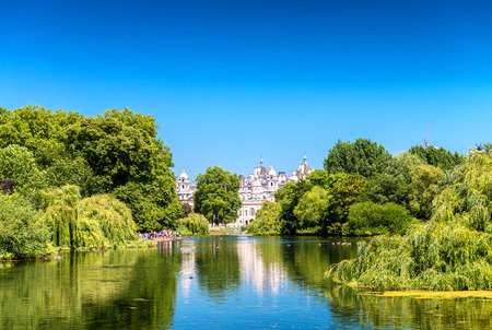 st jamess: St Jamess Park London UK, with buildings, trees and lake. Stock Photo