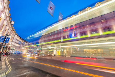 piccadilly: LONDON - JUNE 16, 2015: Traffic in Piccadilly Circus area. Piccadilly signs have become a major attraction of London. Editorial