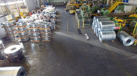 coils: Steel coils in a warehouse, aerial view.