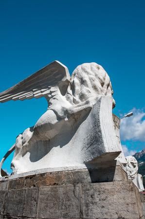 ancient lion: Ancient lion sculpture on a bridge in Auronzo, Italy.
