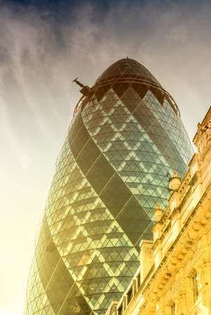 30 st mary axe: LONDON - JUNE 13: View of Gherkin building (30 St Mary Axe) at sunset in London on June 13, 2015. Gherkin - iconic symbol of London, one of citys most widely recognized examples of modern architecture