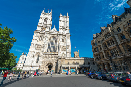 annually: LONDON - JUNE 14, 2015: Tourists near Westminster Abbey. London is visited by 50 million people annually.