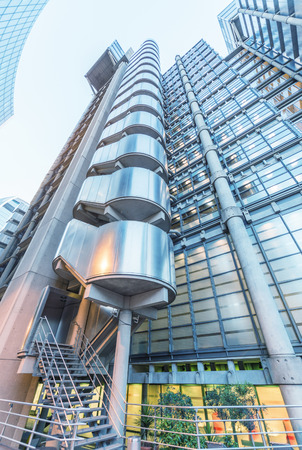 lloyds of london: LONDON - JUNE 12, 2015: City of London skyline at dusk. London attracts 50 million people annually.