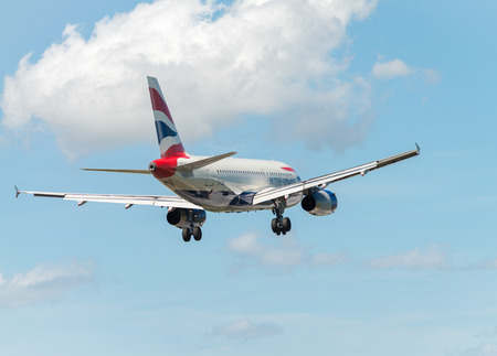 airborne vehicle: PISA, ITALY - AUG 25, 2015: British Airways airplane lands in Pisa airport on August 25, 2015. British Airways is one of the oldest airlines and rated top 3 biggest in Europe.
