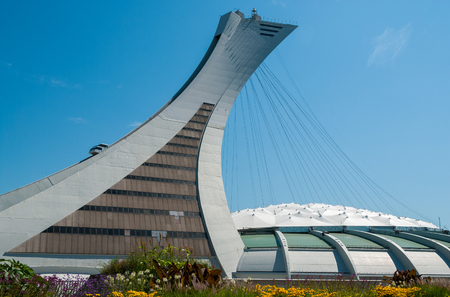 inclined: MONTREAL,CANADA - JULY 28: The Montreal Olympic Stadium and tower on July 18, 2008. Its the tallest inclined tower in the world.Tour Olympique stands 175 meters tall and at a 45-degree angle.