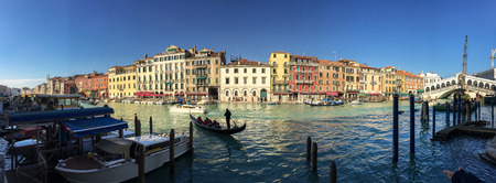 annually: VENICE - FEBRUARY 8, 2015: Tourists along city canals. Venice attracts 20 million people annually.