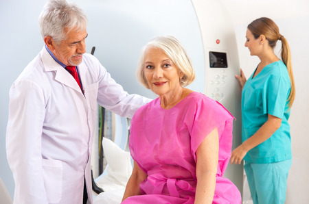 mri scan: Patient undergoing mri scan with doctor assistance.