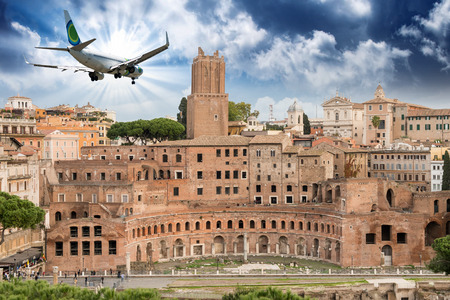 forums: Airplane overflying Imperial Forums in Rome.