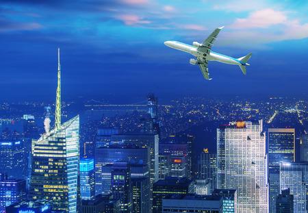 aeroplanes: Airplane overflying modern city.