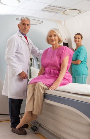 x ray machine: Patient and doctors at mri scan medical machine. Stock Photo