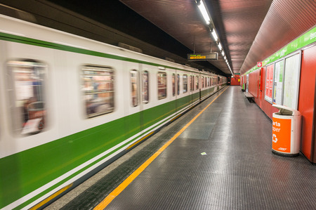 kilometres: MILAN - SEPTEMBER 25, 2015: Interior of city metro station. The network consists of 4 lines, with a total network length of 92 kilometres.