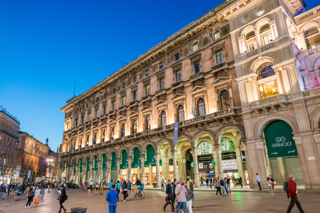 annually: MILAN - SEPTEMBER 25, 2015: Tourists in Piazza del Duomo at sunset. Milan is visited by 5 million people annually. Editorial