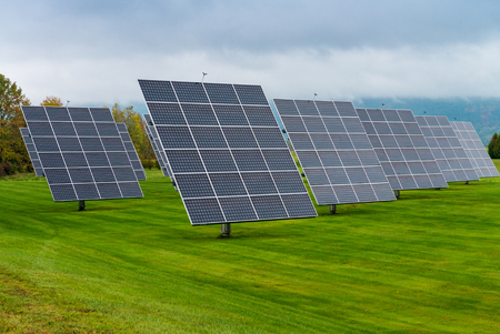 solar equipment: Solar panels placed on a countryside meadow.