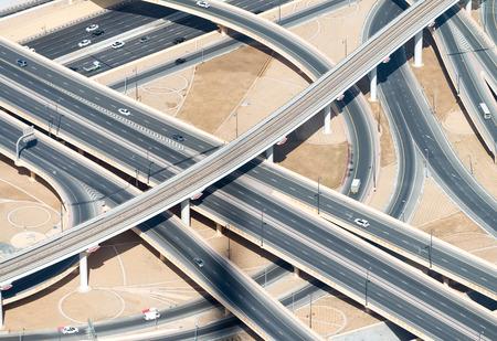 truck on highway: Aerial view of highway interchange of modern urban city.