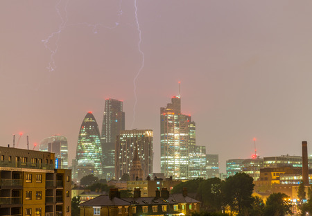 severe weather: London business district under severe weather. Lightning striking