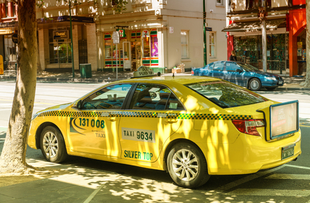 regulated: MELBOURNE, AUSTRALIA - OCTOBER 10, 2015: Yellow cabs in Melbourne, Australia. Taxis in Melbourne are regulated by the Taxi Services Commission which commenced that role on 1 July 2013