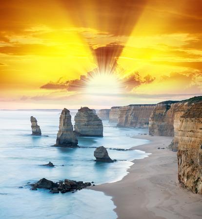 Stunning sunset view of Twelve Apostles, Great Ocean Road - Victoria, Australia.