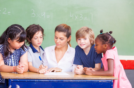 classroom students: Happy children in a multi ethnic elementary classroom.