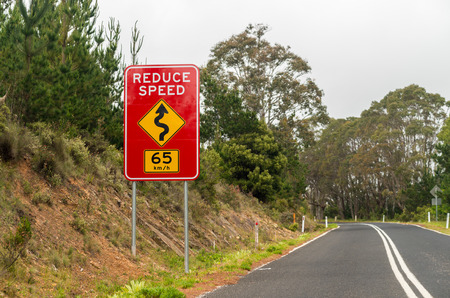reduce: Reduce speed road sign.
