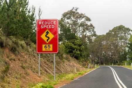 slow lane: Reduce speed road sign.