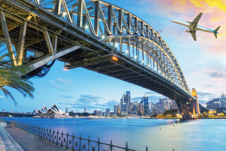 cityscape: Passenger airplane over Sydney, Australia. Travel concept.
