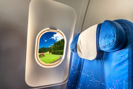 scenario: Airplane window with view on Dolomites scenario. Tourism concept.