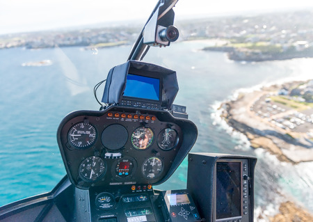 altimeter: Interior of helicopter during flight. Cockpit and instruments.
