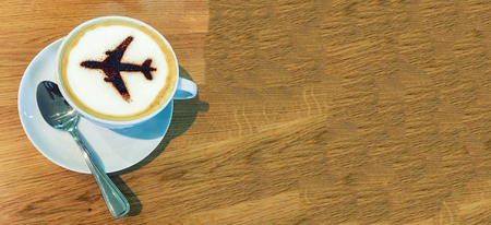 Cup of Coffee with airplane sign on foam. Reklamní fotografie