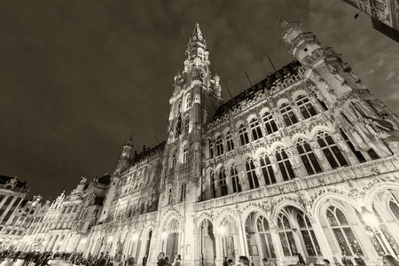 annually: BRUSSELS - MAY 1, 2015: Tourists in La Grand Place, main city square. Brussels attracts more than 10 million people annually.
