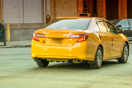yellow cab: Yellow cab in NYC. Taxi along Manhattan street.