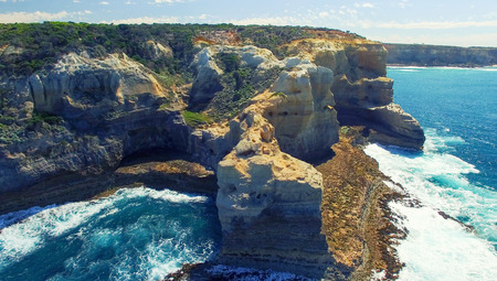 sea cliff: The Arch. Rock formation along Great Ocean Road, Australia. Aerial view.