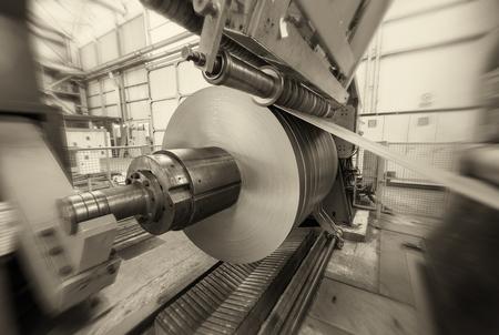 Metal coils machine. Interior of factory. Business concept.
