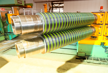 coils: Metal coils machine. Interior of factory. Business concept. Stock Photo