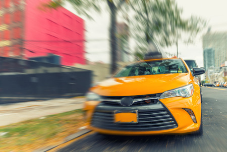 yellow cab: Yellow cab speeding up in New York street. Stock Photo