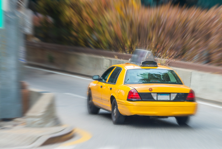 speeding car: Yellow cab in New York Manhattan street.