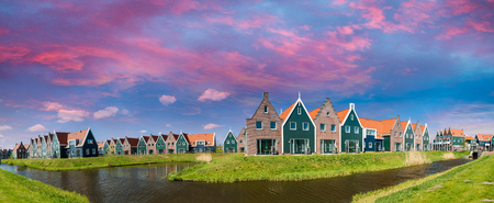 volendam: Panoramic view of homes along Volendam canal, The Netherlands.