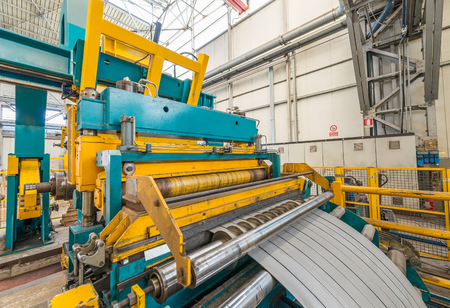 metalwork: Cold rolled steel coil on decoiler of machine in metalwork manufacturing. Stock Photo