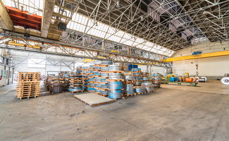 ironworks: Steel coils warehouse. Stock Photo