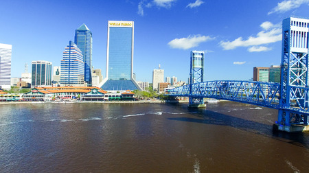 JACKSONVILLE, FLORIDA - FEBRUARY 16, 2016: Aerial city skyline on a sunny day. The city is a famous tourist attraction along the coast..