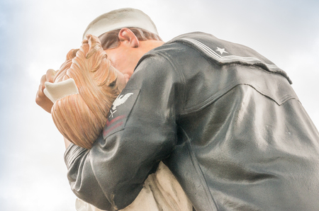 end times: SARASOTA, FL - JAN 13: The statue titled Unconditional Surrender in the center of Sarasota, Florida on January 13, 2016. The statue was hit by a car and removed for repairs on April 27, 2012. Editorial