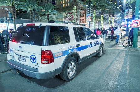 maintains: NEW ORLEANS - JANUARY 21, 2016: A police car in the French Quarter in New Orleans. The city maintains a high police presence to protect the tourist industry, an income source.