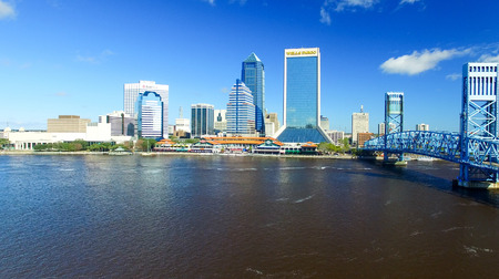 JACKSONVILLE, FLORIDA - FEBRUARY 16, 2016: Aerial city skyline on a sunny day. The city is a famous tourist attraction along the coast. Editorial